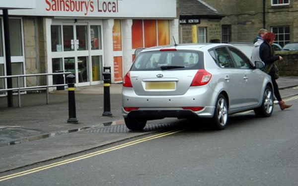 Sainsburys before Bollards - car parked across tactile pavement